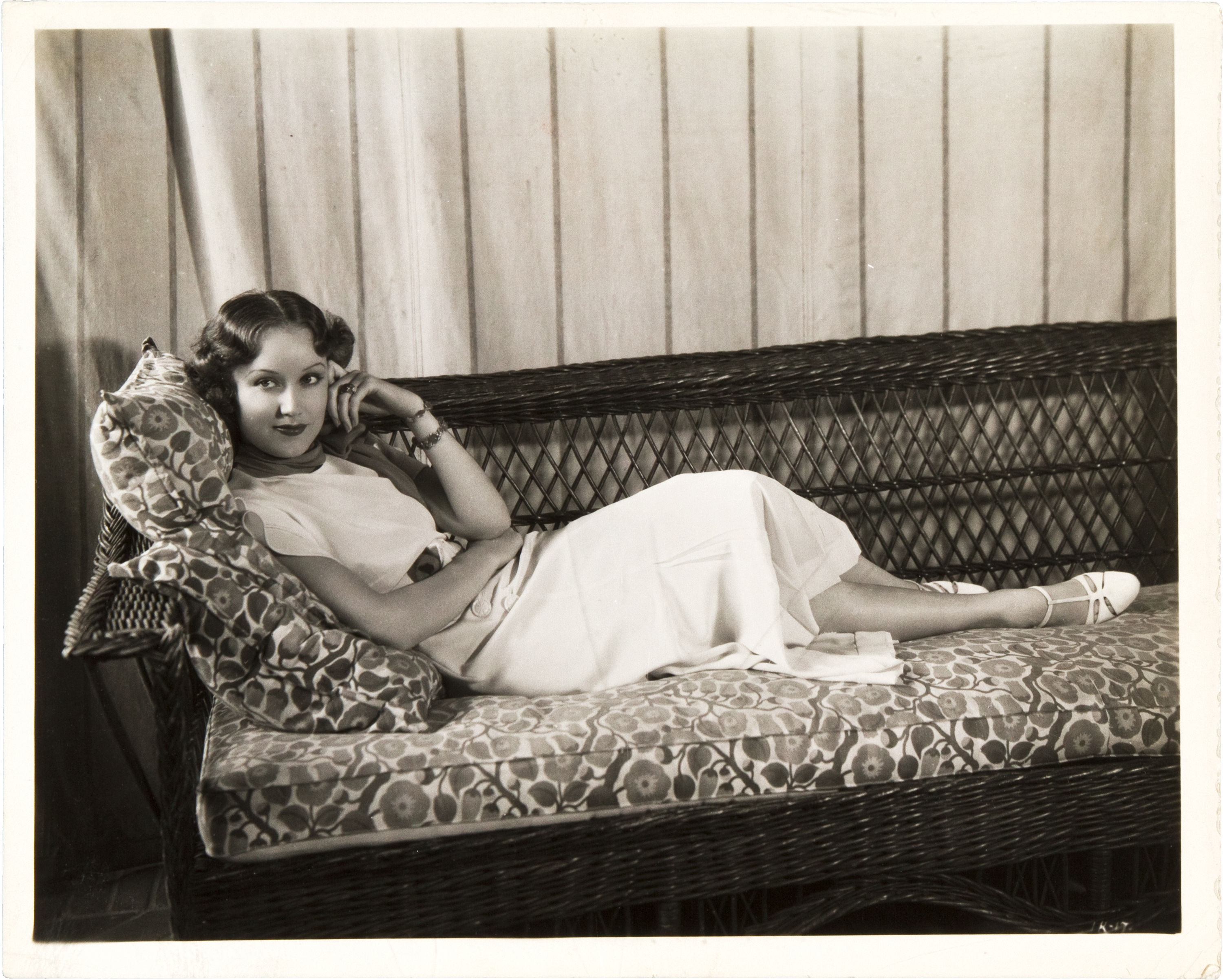 Fay Wray lounging on a sofa